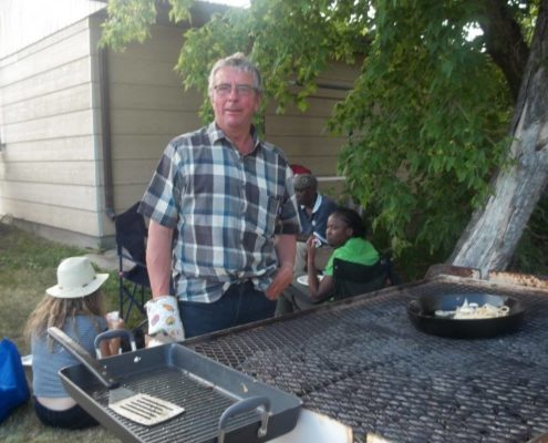 Clem Perrault on barbecue duty at AFZP's Saint Jean Baptiste celebrations