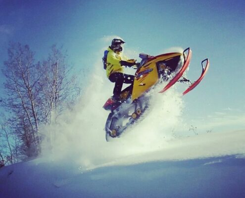 Local snowmobiler having fun in the snow