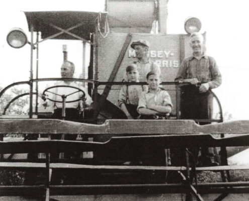 Gilbert Marchildon and sons on Massey-Harris self-propelled combine