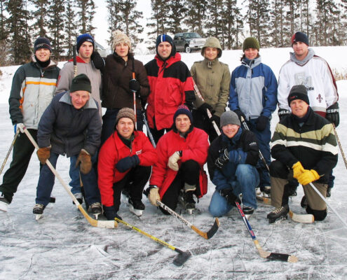 Traditional pond hockey game on Marchildon farm near Zenon Park